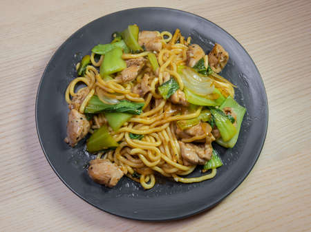A plate of chicken and vegetable yakisoba (fried noodle). Stock Photo
