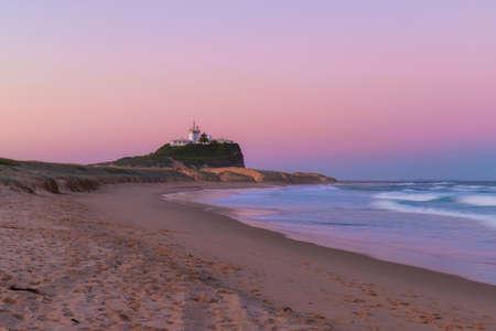 Dusk view of Nobbys lighthouse from Nobbys Beach, Newcastle, Australia. Stock Photo