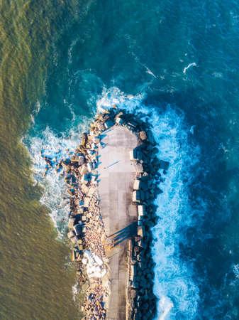 Top down view of the edge of Newcastle breakwall, Australia. Stock Photo