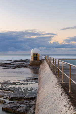 Merewether rock pool pumphouse in the morning. Stock Photo