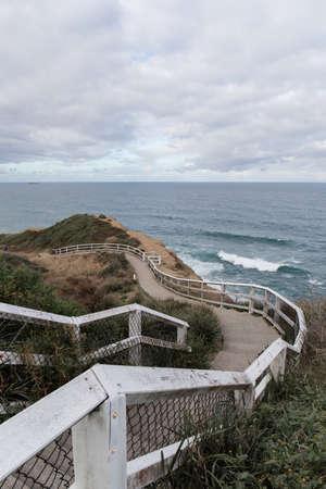 Empty walking path at Newcastle coastal walk, Australia. Stock Photo