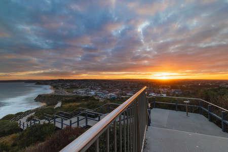 Cloudy sunset view at Anzac Memorial Walk, Newcastle, Australia.