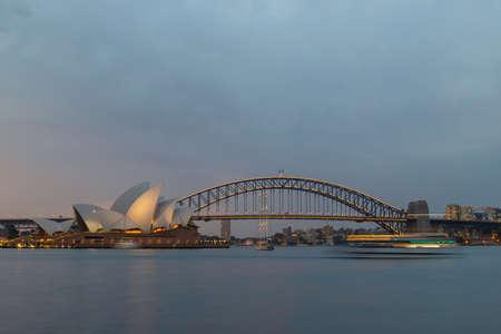 Sydney, Australia - November 21, 2020: Sydney Harbour Bridge and Opera House view after sunset.