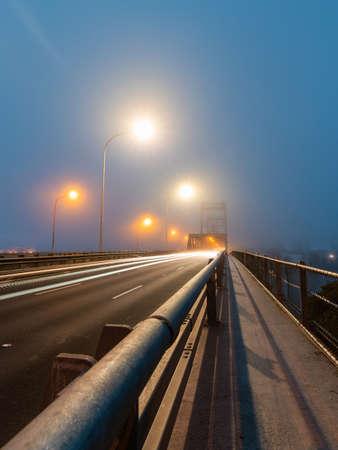 Car driving through fog at Ryde Bridge, Sydney, Australia. Foto de archivo
