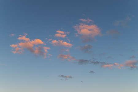 Beautiful colorful clouds on blue sunset sky. Standard-Bild