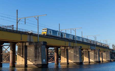 Sydney, Australia - August 14, 2021: Train passing through John Whitton Bridge across Parramatta River. Editorial