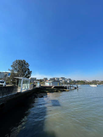 Sydney, Australia - August 21, 2021: Boat shed at Meadowbank with clear blue sky.