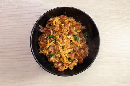 A bowl of fusilli pasta.