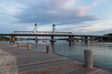 Sydney, Australia - August 30, 2021: A ferry travel under Ryde Bridge at Parramatta River.
