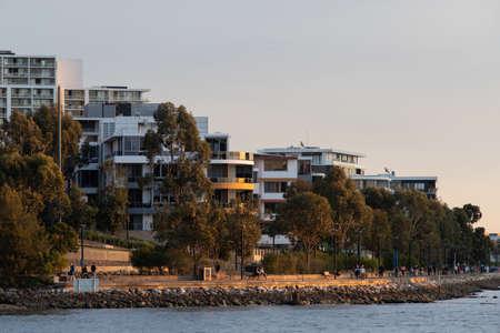 Sydney, Australia - September 9, 2021: Golden sunlight view over Rhodes shoreline. Editorial