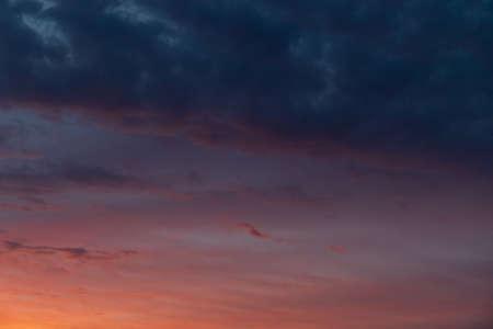 Sky cloudscape with orange-blue gradient.