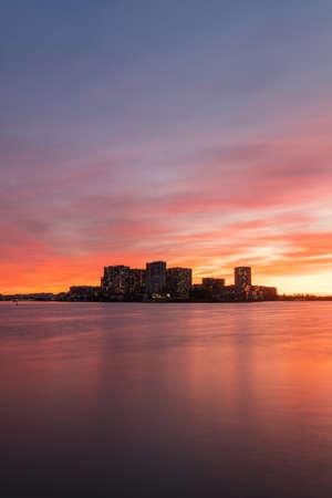 Sunset view over Wentworth Point waterfront skyline, Sydney, Australia.