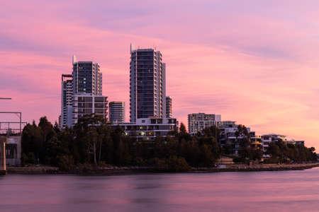 Sunset view over Rhodes building skyline, Sydney, Australia. Standard-Bild