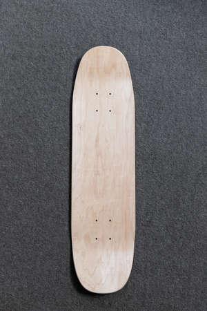 Top down view of blank skateboard deck.