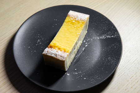 Slice of cheesecake on a small plate.