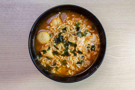 A bowl of hot and spicy noodle soup.
