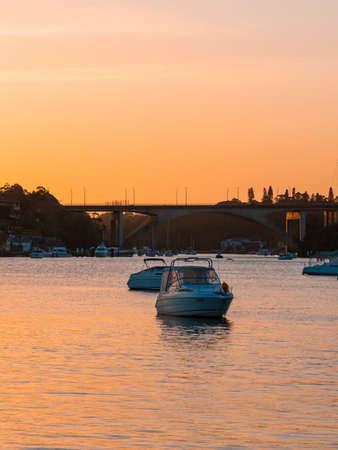 Sydney, Australia - October 8, 2021: Sunset view of boats at Tarban Creek.