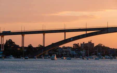 Sydney, Australia - October 8, 2021: Close-up view of Gladesville Bridge at sunset time.