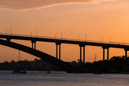 Sydney, Australia - October 8, 2021: Silhouette of Gladesville Bridge at sunset time.