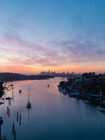 Sydney, Australia - October 9, 2021: Dawn view of Sydney skyline with colorful clouds. Editorial