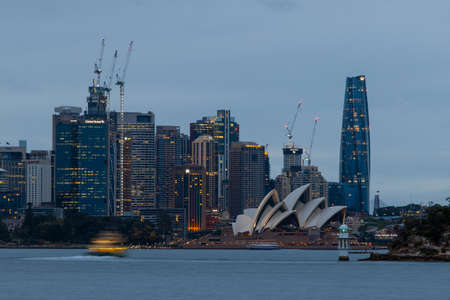 Sydney, Australia - October 12, 2021: Overcast view of Sydney Opera House and the surrounding buildings.