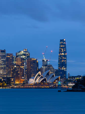 Sydney, Australia - October 12, 2021: Sydney Opera House and CBD skyline at night. Editorial