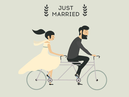 Just married wedding couple riding bicycle
