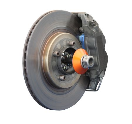frenos: Un disco de freno y Pinza de un coche de carreras. Foto de archivo