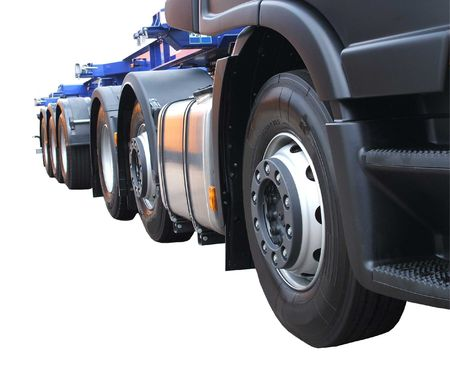 The Wheels of a Large Lorry on a White Background.