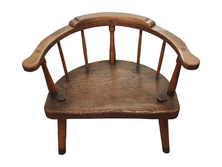 antique chair: A Round Backed Wide Antique Wooden Chair. Stock Photo