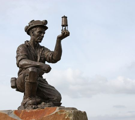 A Statue of a Coal Miner Testing for Gas.