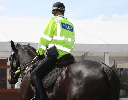 constabulary: A Police Constable on Duty on a Police Horse. Stock Photo