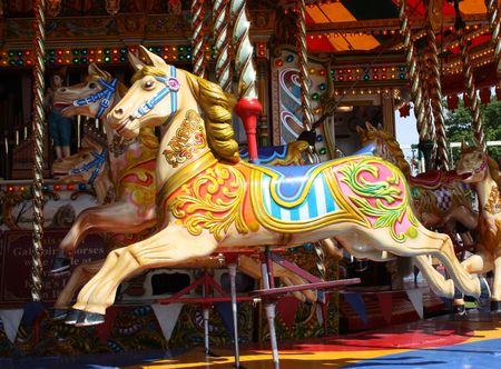 A Colourful Carousel Horse on a Fun Fair Ride. Stock Photo