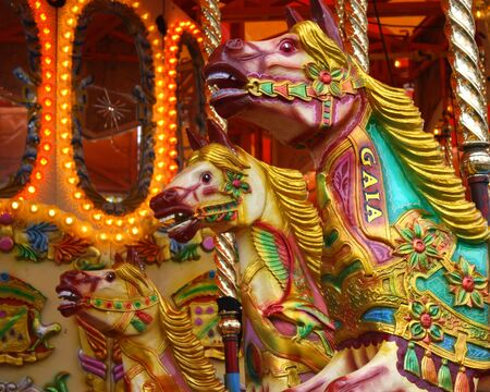 A Group of Carousel Horses on a Fun Fair Ride.
