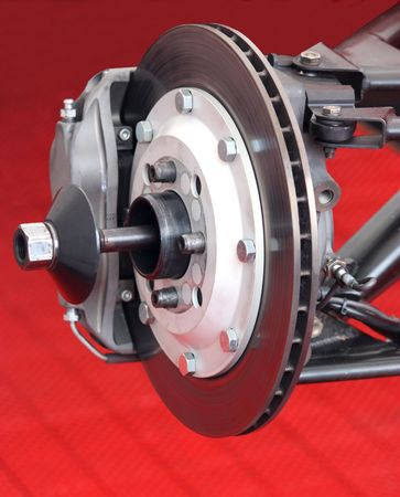The Front Brake Disc Assembly of a Racing Car. Stock Photo