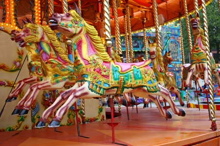 fun fair: A Colourful Carousel Horse Ride at a Fun Fair.
