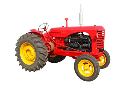 A Bright Red Modern Agricultural Farming Tractor. Stock Photo
