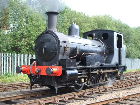 A Black Vintage Classic British Steam Locomotive. Stock Photo