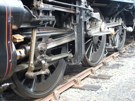 round rods: The Wheels of a Powerful Steam Locomotive. Stock Photo
