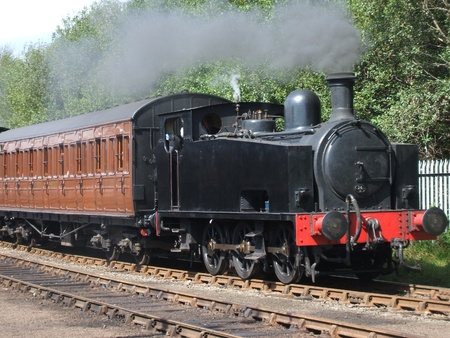 A Traditional British Steam Engine and Train. Stock Photo - 8546468