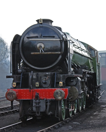 A Large Black Vintage Steam Train Engine. photo