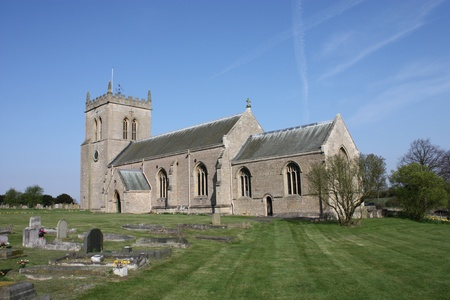 A Traditional English Country Church with a Tower. photo