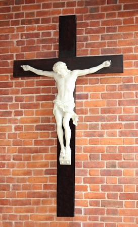A Depiction of a Crucifixion on a Wooden Cross. photo