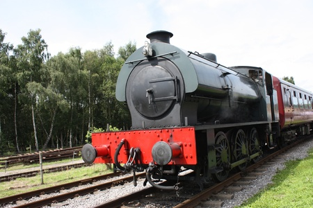 A Saddleback Vintage Steam Engine and Train. Stock Photo - 9248090