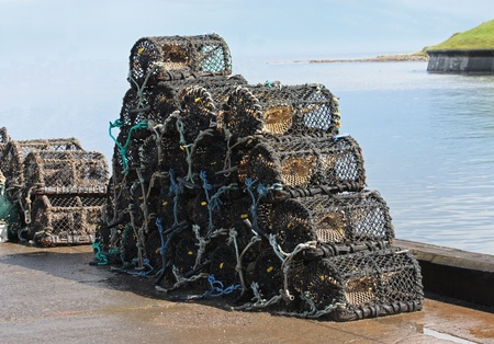 crab pots: A Stack of Crab and Lobster Fishing Pots. Stock Photo