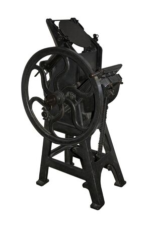 An Old Fashioned Black Metal Vintage Printing Press. Stock Photo