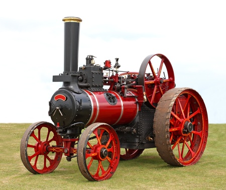 traction: A Black and Red Vintage Traction Steam Engine.