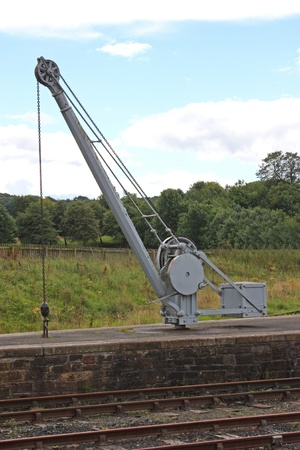 A Vintage Cargo Crane on a Trackside Railway Platform. Stock Photo - 10331170