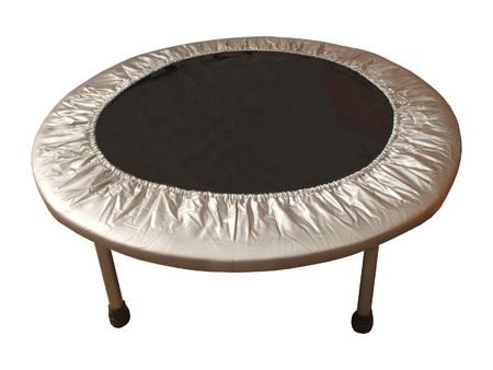 A Black and Silver Indoor Exercise Trampoline. Stock Photo