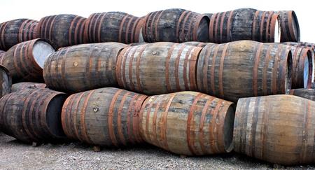 A Stack of Empty Wooden Oak Whisky Barrels.